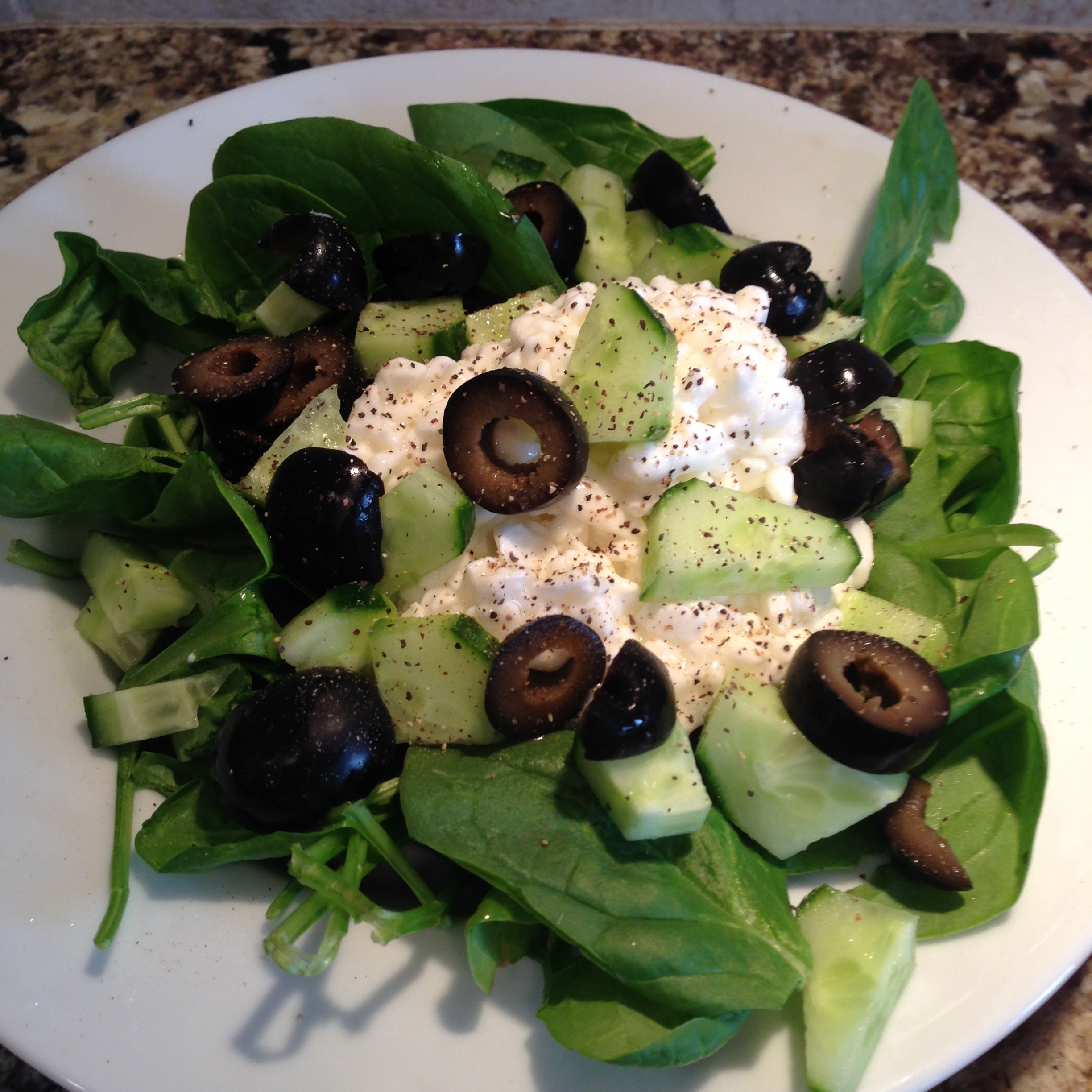Cottage Cheese with Cucumbers, Black Olives, and Spinach Salad