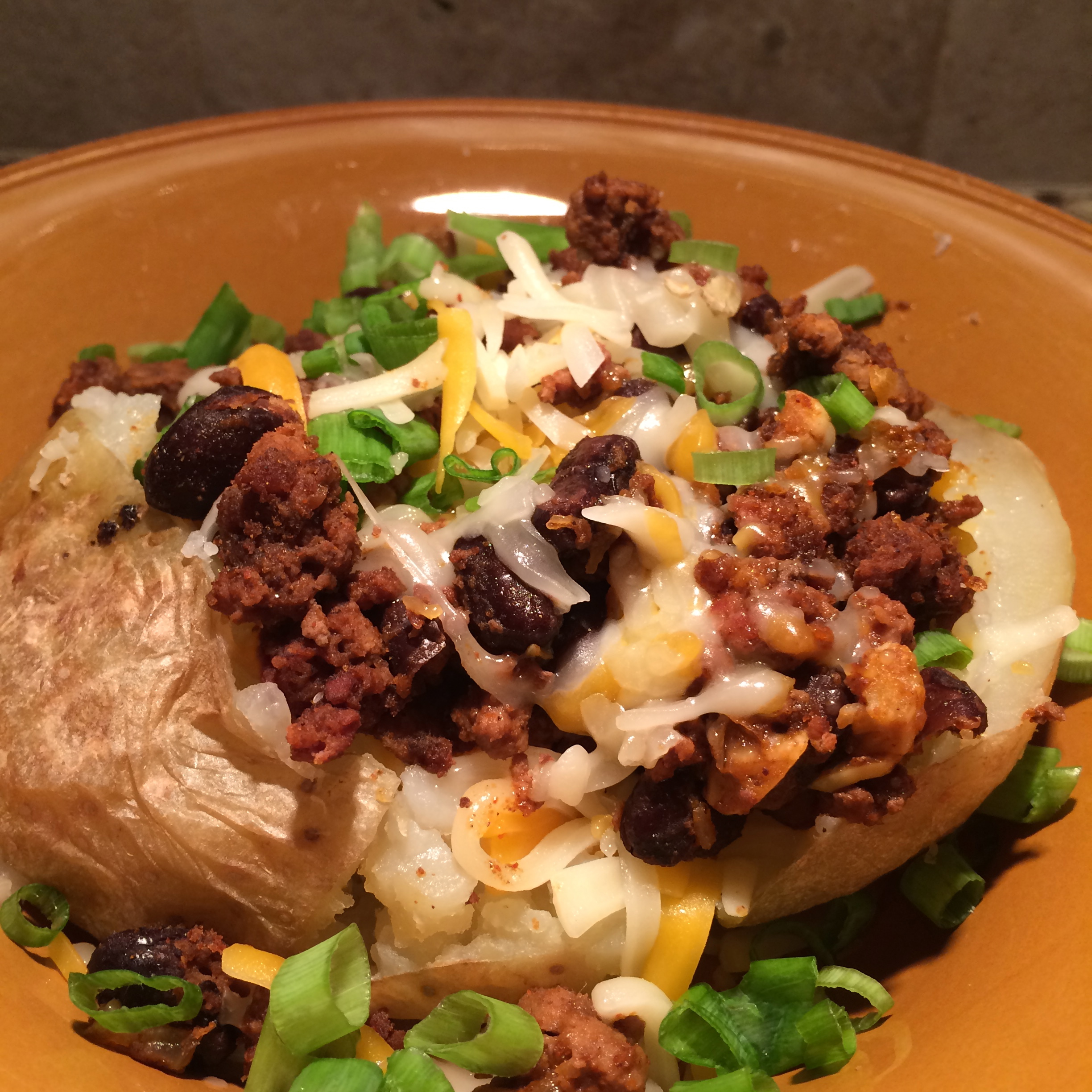 Taco Meat and Black Bean Baked Potato