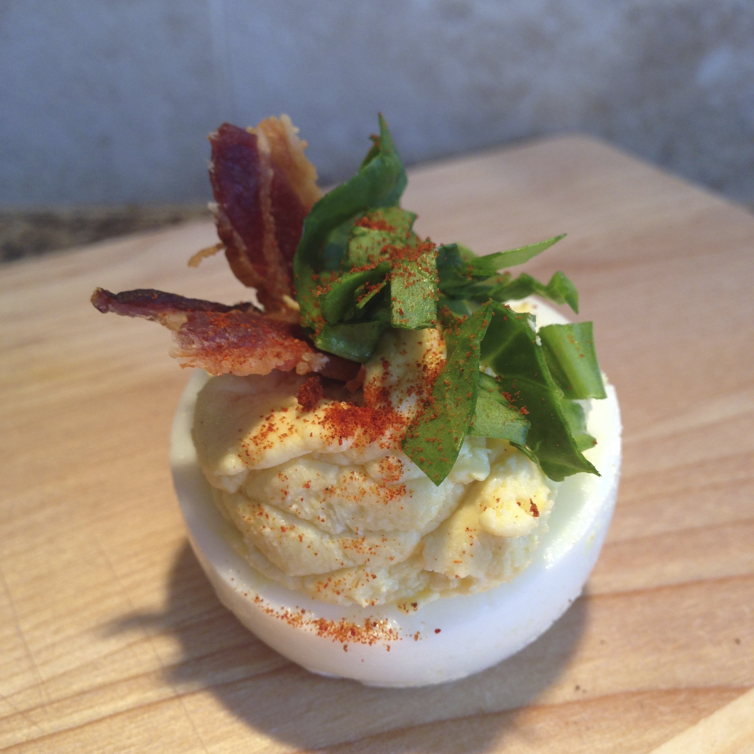 Deviled Eggs with Bacon and Agrugula